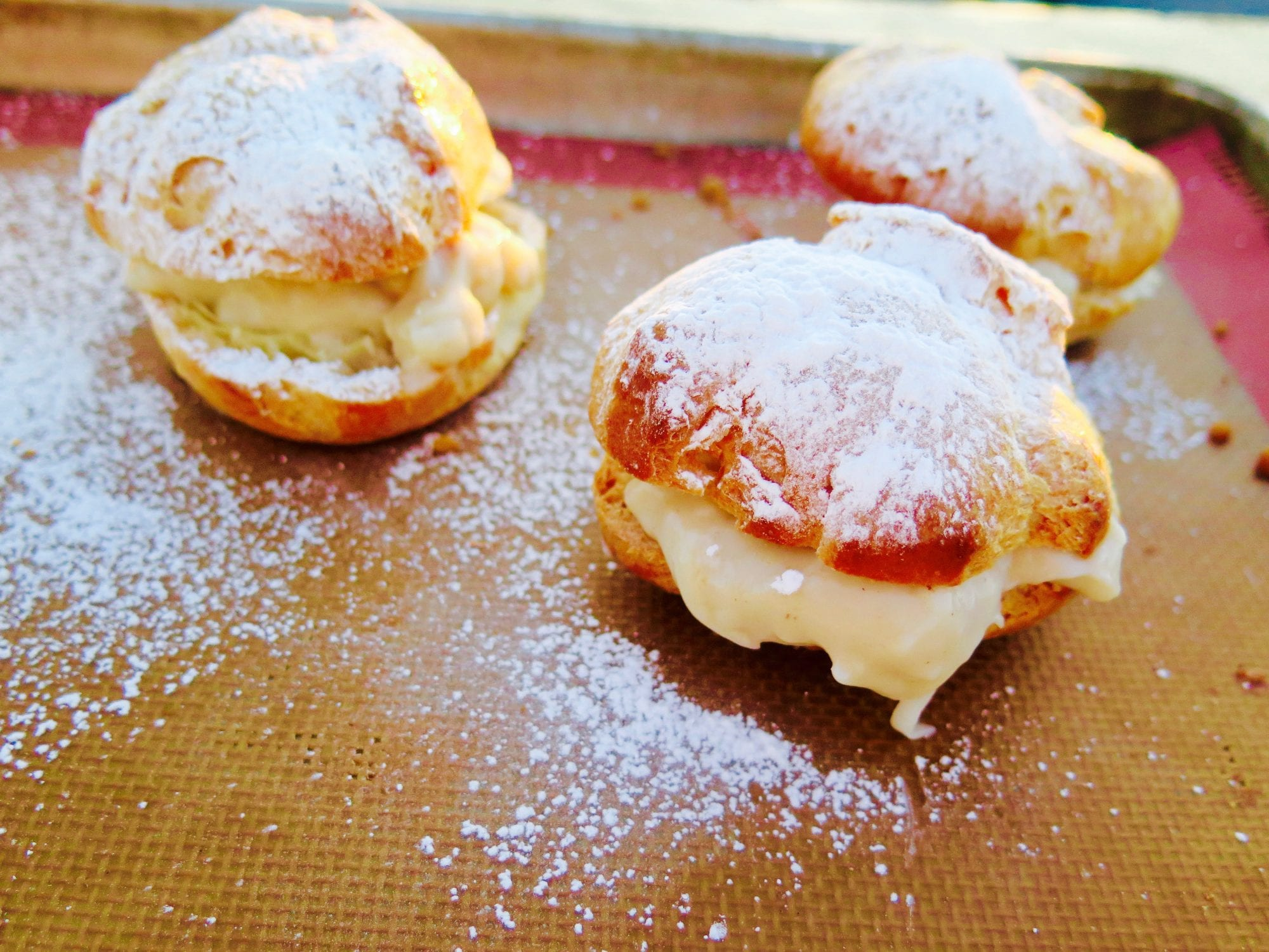 cream puffs filled with coconut pastry cream